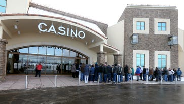 People wait outside del Lago Casino for its grand opening in Tyre on Feb. 1, 2017.