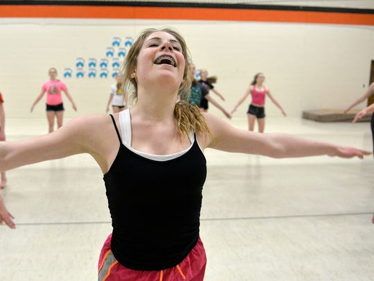 Brittany Noble strikes a pose as she and the other members of the St. Cloud Tech Tigerettes dance team practice their routines Monday, Feb. 8, to prepare for their upcoming state tournament appearance. She and her sister, Brooke, are one of the three sets of sisters on the team.