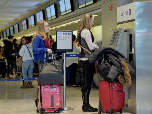 united airlines passengers check in at kennedy international airport