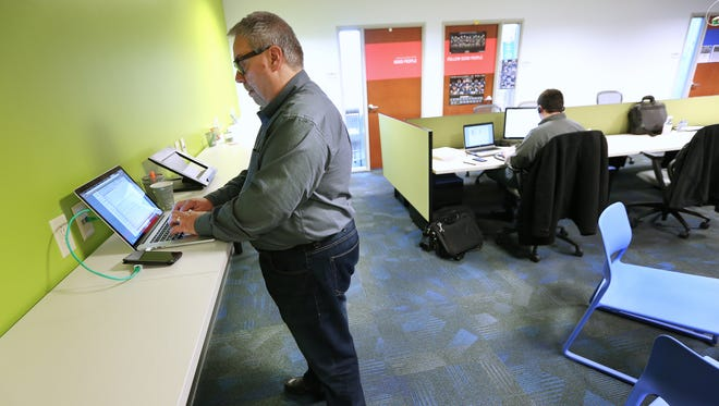 Dave Leininger, a senior consultant, works on a project inside the Fusion Alliance offices on March 5, 2015. Fusion Alliance, a web development and technology consulting company located on Indianapolis' Northwestside, is No. 1 among midsize companies in the 2015 list of Top Workplaces in Central Indiana.