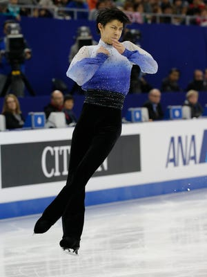 Yuzuru Hanyu of Japan performs during the Mens Short Program event in the ISU World Figure Skating Championship 2015 held at the Oriental Sports Center in Shanghai, China.
