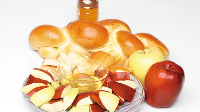 If you'd like to sample some Rosh Hashanah sweetness, challah can be bought at some supermarkets and at Jewish bakeries. Your family can cut up some apples and challah, then dip them in honey.