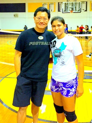 Samantha Quinata, right, is shown with Dr. Thomas Shieh at the 16th Annual Shieh High School Invitational Volleyball Tournament. Shieh, an obstetrician, delivered Quinata 16 years ago, and her team, the George Washington Geckos, won the tournament this year.