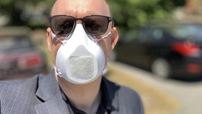 Durham Town Administrator Todd Selig wears his face mask in Durham where a face covering request was ordered on May 28. Cities and towns around the state are considering similar measures as business begin to reopen more and residents begin to leave their homes more often.