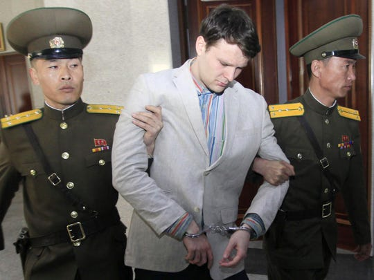 American student Otto Warmbier, center, is escorted at the Supreme Court in Pyongyang, North Korea on March 16, 2016. North Korea sentenced Warmbier, a 21-year-old University of Virginia undergraduate student, from Wyoming, Ohio, to 15 years in prison with hard labor for subversion. He allegedly attempted to steal a propaganda banner from a restricted area of his hotel.