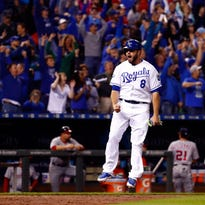 Mike Moustakas (8) celebrates as he scores the game-winning run in the bottom of the 9th inning.