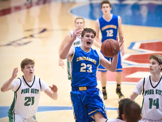 Cathedral's Michael Schaefer tries to grab a rebound during the first half of the Tuesday Section 6-2A playoff game against Pine City last March at St. John's University in Collegeville.