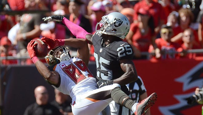 Tampa Bay Buccaneers wide receiver Russell Shepard catches a touchdown pass over Oakland Raiders defensive back D.J. Hayden, right, on Oct. 30, 2016.