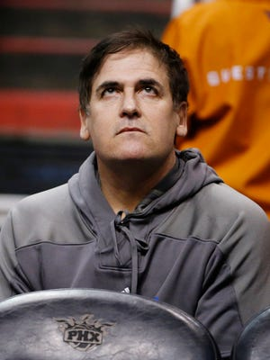 Dallas Mavericks owner Mark Cuban looks up at the scoreboard during the second half of an NBA basketball game against the Phoenix Suns Tuesday, Dec. 23, 2014, in Phoenix.  The Suns defeated the Mavericks 124-115. (AP Photo/Ross D. Franklin)