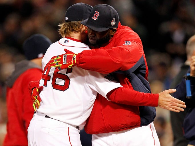 Game 1 -- Red Sox 8, Cardinals 1:  Red Sox designated hitter David Ortiz hugs pitcher Ryan Dempster after defeating the St. Louis Cardinals at Fenway Park.