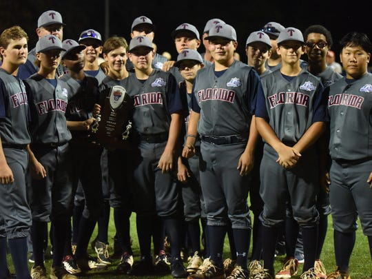 Members of the Tallahassee, Fla., team pose with the runner-up trophy at the Babe Ruth World Series on Thursday night.