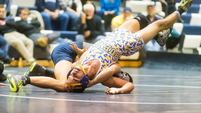 St. Augustine's Connor Kraus (126-lb) takes on Buena Regional's Junior LaPortez at St. Augustine Prep on Tuesday.