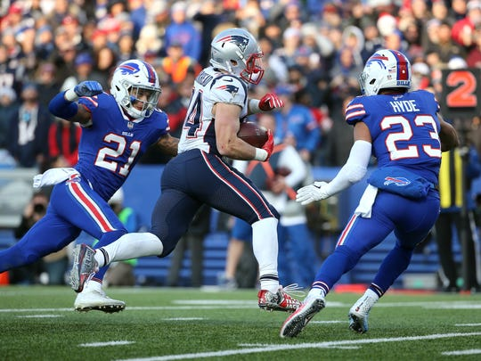 Bills safety Jordan Poyer and Micah Hyde try to tackle Patriots running Rex Burkhead on this 14-yard touchdown run.