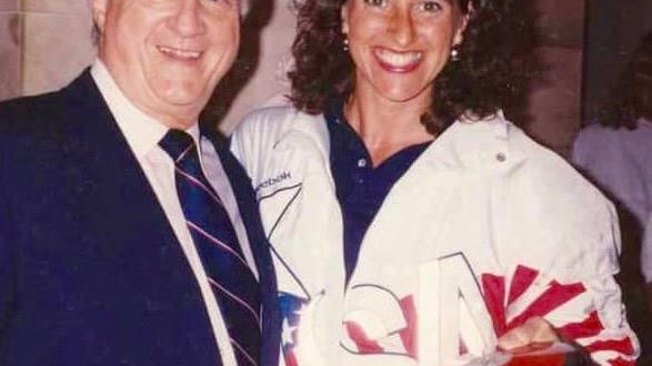Penny Neer meets George Steinbrenner, former owner of the New York Yankees, who adds his name to the discus she takes to the White House in 1992.