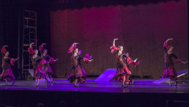 "Alamogordo's Academy of Ballet dancers performed on stage with the State Street Ballet dancers during their Flickinger Center's performance of ""Carmen"" March 15. From left: Riley Black, Brittany Hymer, Mariah Hernandez, Ariana McLeod, Kyra Zartner, Casen Collins, Jessica Ansell and Rachel Breck perform during the ""Carmen"" ballet. State Street Ballet is an internationally renowned contemporary ballet company based in Santa Barbara, California."
