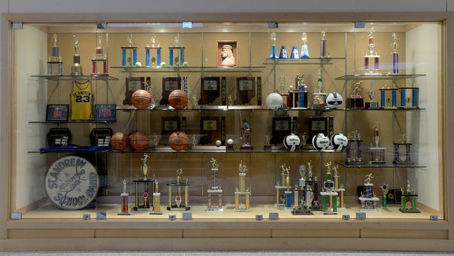 The trophy case in the lobby of the Chuck Mosey Memorial Gymnasium at Seton Catholic High School is filling up fast.