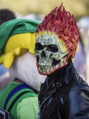 Ghost Rider takes pictures with fans during Tempe Public