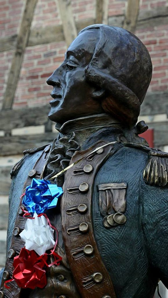 The West Market Street, York, statue of Marquis de Lafayette is decorated in red, white and blue on Nov. 15. That day marked the 238th anniversary of the adoption of the Articles of Confederation.