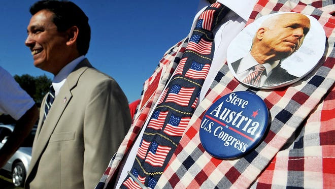 """Karlheinz Hooper, of the Republican Central Committee, wears a """"Steve Austria US Congress"""" badge and a John McCain button on his lapel as Congressman Steve Austria greets supporters at the home of Col. Tom Moe in Lancaster on Oct. 1, 2008."""