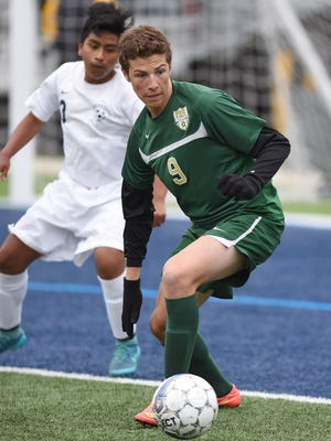 FDR's Ethan Hart looks for a way to shoot on goal as  Poughkeepsie's Ulises Rojas covers him during Thursday's game in Poughkeepsie.