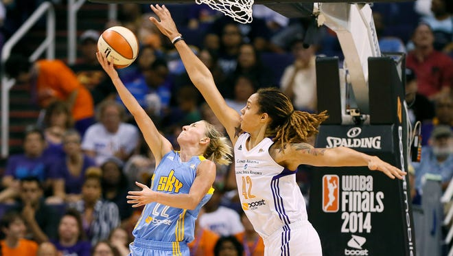 Phoenix Mercury center Brittney Griner (42) blocks the shot of Chicago Sky guard Courtney Vandersloot during the first half of  Game 2 of the WNBAFinals on Tuesday, Sept. 9, 2014, in Phoenix.