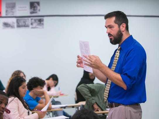 Social studies teacher, Nathan Moser, leads a class