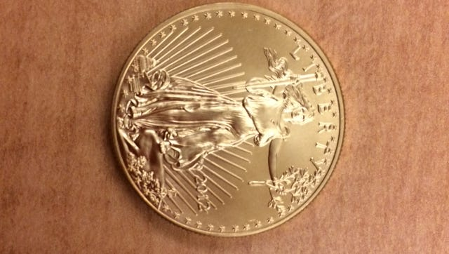 This gold coin was dropped in a Salvation Army kettle at Cabela's in Ashwaubenon.