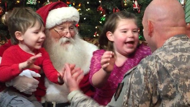 Braddock, 2, and Reilly, 5, were reunited with their father, Sgt. Michael Archibald as they sat on Santa's lap. Archibald is just back from a nine-month tour of duty in Kuwait.