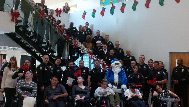 Members of the Phoenix Police Department pose with special needs patients during a holiday event.