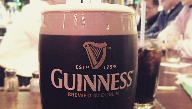 A pint of Guinness at a packed Dunne's Pub in White Plains on St. Patrick's Day.
