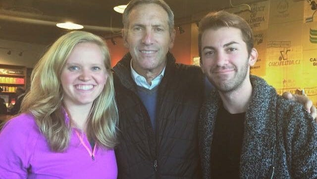 Starbucks CEO Howard Schultz, center, poses for a picture with Jenna King, left, and Kyle Osman, of Red Lion, during a visit to a Manchester Township Starbucks location on Thursday, Nov. 19, 2015.