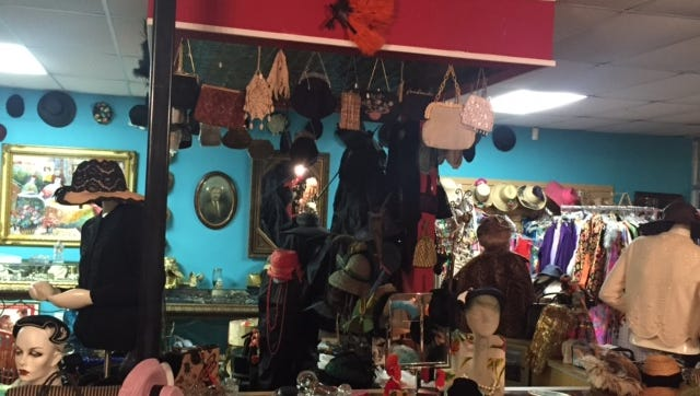 The Curiosity Shop has moved to a bigger location in Fort Myers and expanded its vintage clothing and jewelry collection to include furniture and art.