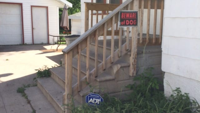 Beware of dog signs are posted on the home of Tina Jones in the 1100 block of Reber Street.