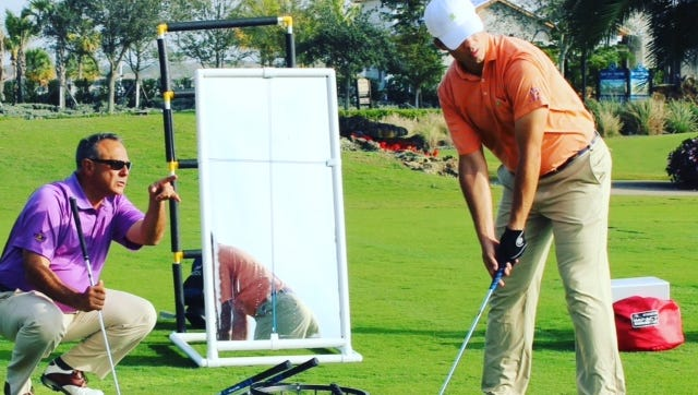 Instructor Tom Patri, who has a golf school at Esplanade Golf & Country Club, works with a student.