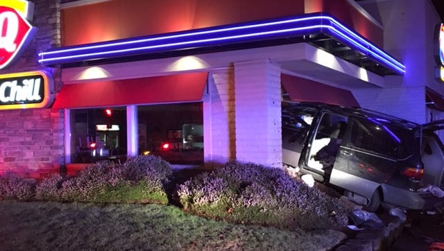 A man was hospitalized early Christmas morning after driving into a Dairy Queen on Lancaster Drive NE.