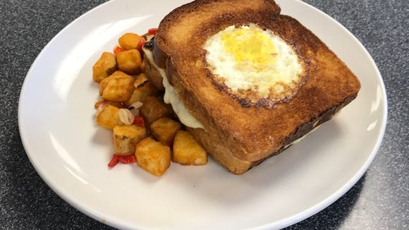 A grilled cheese sandwich become brunch-worthy with the addition of a fried egg-in-the-hole at The Pour House.
