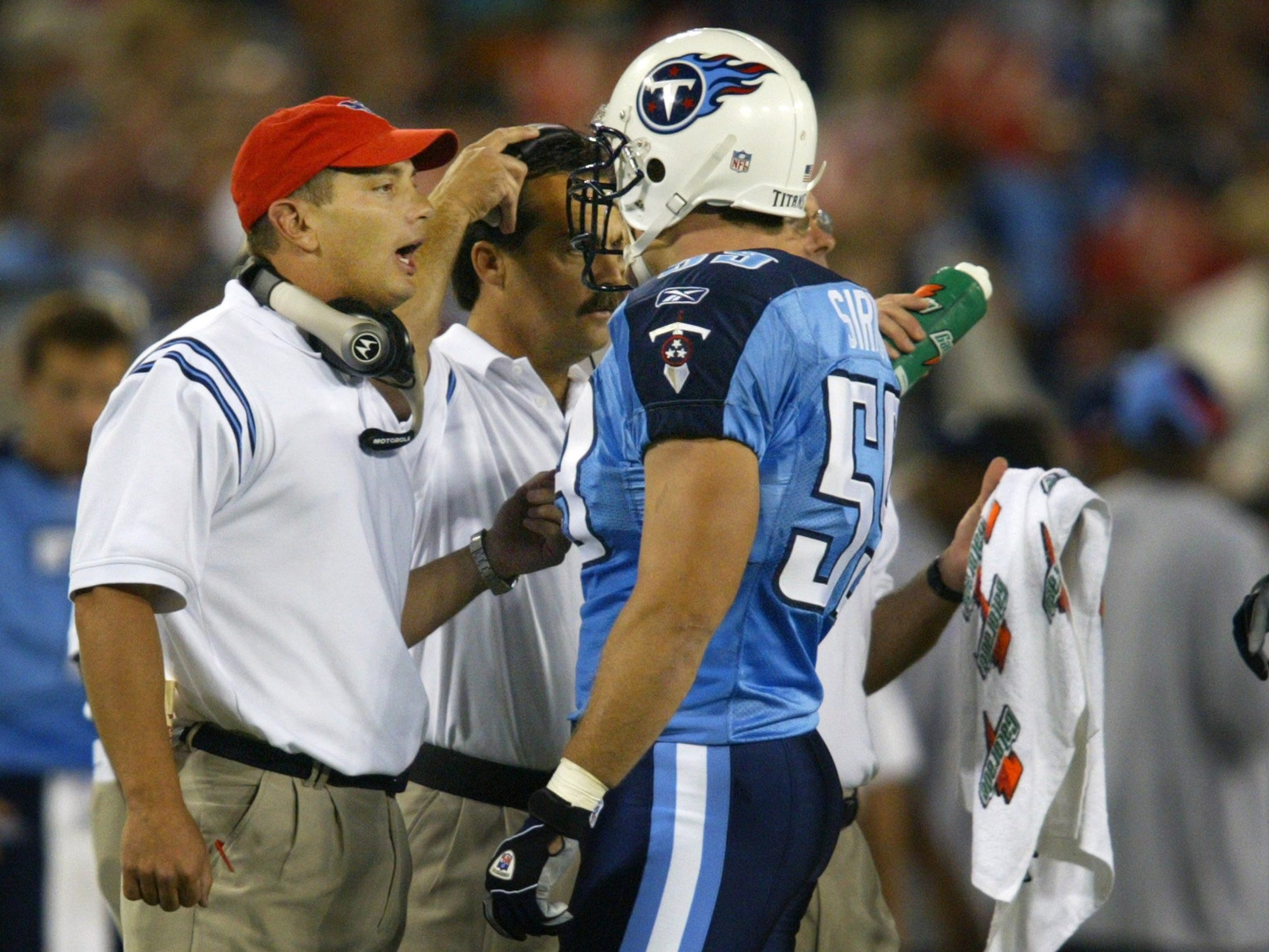 Peter Sirmon, right, developed a special bond with then-Titans defensive coordinator Jim Schwartz, impressing the coach with his love and knowledge of football.