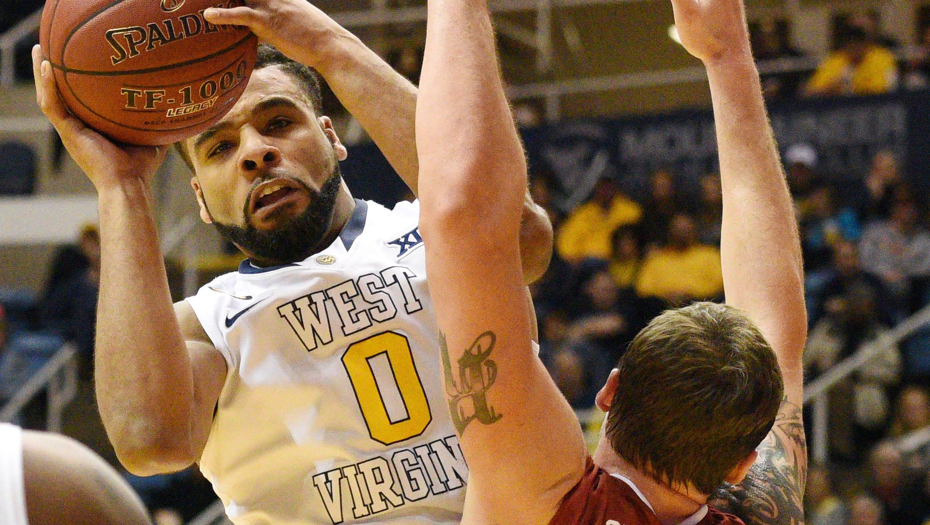 No. 15 West Virginia beats No. 18 Oklahoma