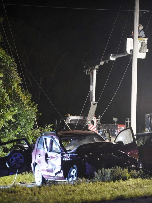 A Met Ed power crew work to repair a damaged pole after Wednesday night's multi-vehicle crash on Route 22  at North Lancaster Street in Swatara Township in which 19-year-old Kevin Depugh of Jonestown was killed.