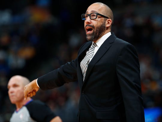 Memphis Grizzlies coach David Fizdale gestures during the second half of the team's NBA basketball game against the Denver Nuggets on Friday, Nov. 24, 2017, in Denver. The Nuggets won 104-92. (AP Photo/David Zalubowski)
