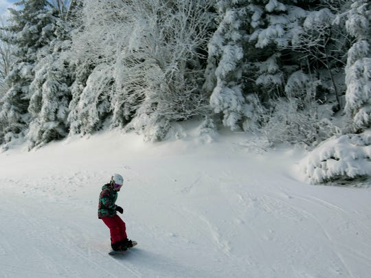 A young snowboarder takes the first run of the season on top of the mountain on opening day at Loon Mountain ski resort Wednesday, Nov. 23, 2016, in Lincoln, N.H. Many ski areas in Northern New England plan to open for the Thanksgiving weekend.