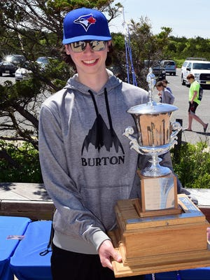 Sixteen-year-old Kyle Brendel of Nutley  holds N.J. Governor's Cup after winning the 26 Governor's Cup Surf Fishing Tournament at Island Beach State Park on  May 21, 2017.