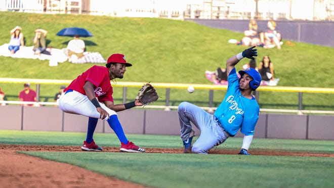 Amarillo Sod Squad shortstop Jose Torres (left) awaits a throw as Amarillo Sod Dogs Eduardo Acosta slides into second base during a game in last week's series at Hodgetown.