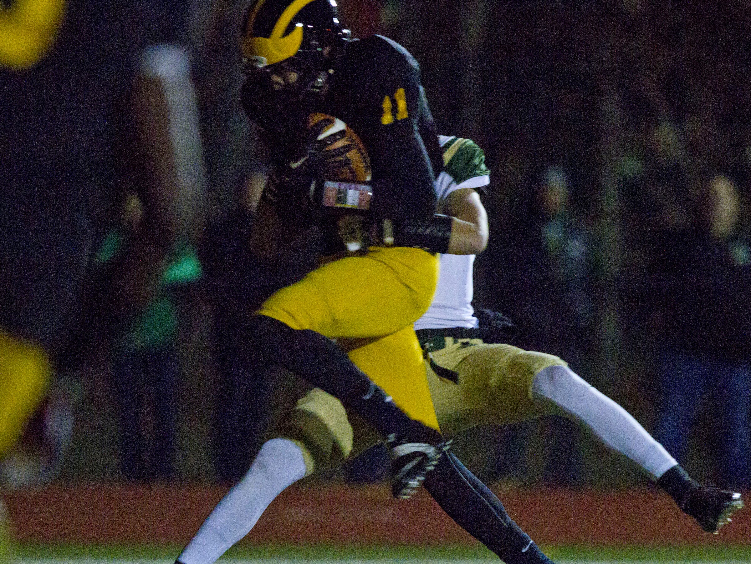 SJV's Michael Stapert makes a touchdown reception. Defending is Red Bank Catholic's Max Hazard. Red Bank Catholic vs St. John Vianney Non-Public Group III semifinal football game. Holmdel, NJ Friday, November 20, 2015 @dhoodhood