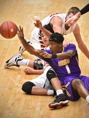 Minnesota State-Mankato's Jalen Pendleton tries to pass the ball during Saturday's game at Halenbeck Hall in St. Cloud.