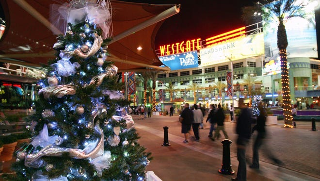 People walk through the holiday display at Westgate City Center Wednesday, Nov. 28, 2007 in Glendale.