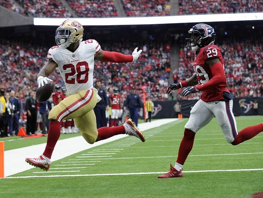 FILE - In this Dec. 10, 2017, file photo, San Francisco 49ers running back Carlos Hyde (28) run past Houston Texans free safety Andre Hal (29) for a touchdown during the first half of an NFL football game, in Houston. A person familiar with the negotiations says the Browns are expected to sign free agent running back Carlos Hyde. The team has an agreement with Hyde and will finalize the deal at 4 p.m. Wednesday, March 14, 2018, said the person who spoke on condition of anonymity because teams are prohibited from announcing any deals until the end of the NFL's two-day negotiating period. (AP Photo/Eric Christian Smith, File)