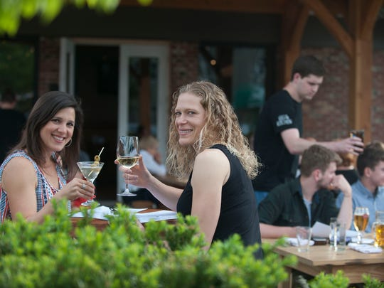 Kate Kruza and Rosa Marden enjoy themselves on a nice day at the new outdoor beer garden at Keg & Kitchen in Westmont.