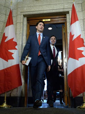 Prime Minister Justin Trudeau, followed by Minister of Finance Bill Morneau, leaves the Prime Ministers office in March.