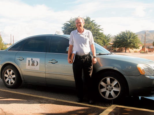 Dwayne Severs, co-owner and founder of Alamogordo's new restaurant delivery service, D&D Delivery, stands outside his delivery car, ready for another day of driving.